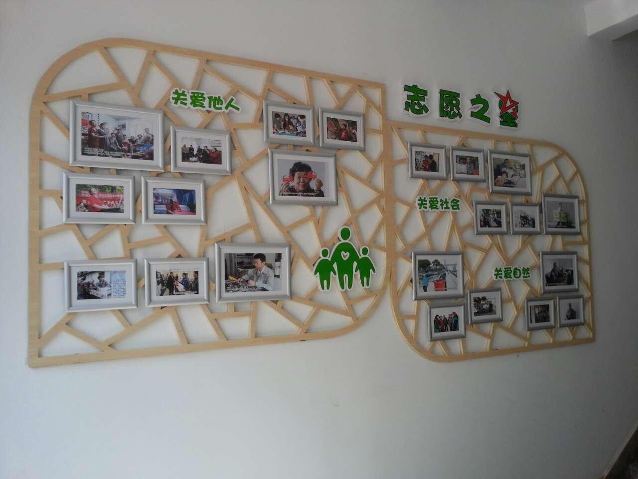 """设计师通过闵行文字展示了闵行区志愿服务工作组织分布,以中地图""""心""""木现代整图计设图片"""
